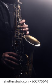 Saxophone player Saxophonist playing instrument jazz music Sax alto hands closeup