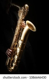 Saxophone player Saxophonist playing jazz music. Baritone sax player