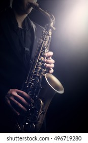 Saxophone Player Saxophonist playing jazz music. Alto sax player with musical instrument