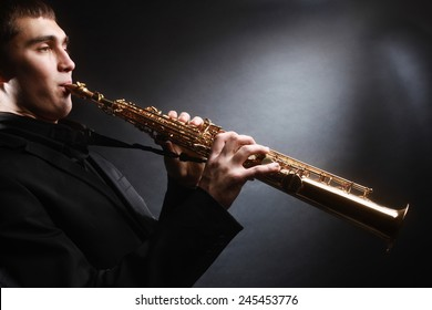 Saxophone player. Saxophonist with soprano sax Man with musical instruments