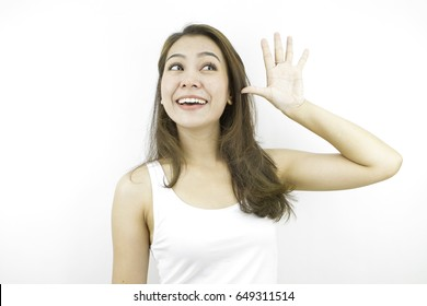 Say hello or good bye, thinking positive and looking front with happy smiling face, posing in white casual dress, posing by asian woman at studio in grey background.