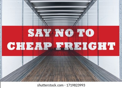 Say no to cheap freight written on empty commercial semi trailer interior. Concept of american truckers protest due to load rates being cut by freight brokers. Transportation owner operators strike.