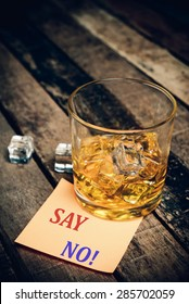Say No ! with label on paper note. Glass of scotch whiskey