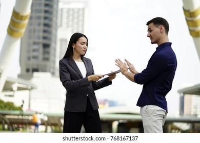 Say No, Not accept. Saleswoman offering a sale  to a business man customers that rejects to sing a contract. Sales woman insurance offering a paper to customers and that customers was rejects, say No