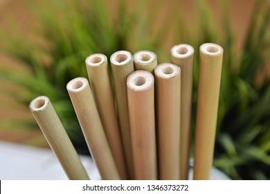 Say NO to plastic, natural bamboo drinking straws, close up view.