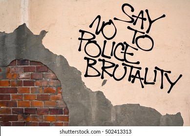 Say No To Police Brutality - handwritten graffiti sprayed on the wall - critique and fight against cops and their misusing of power, brutal and excessive violence and assault