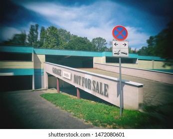 It says on the wall - garage not for sale, traffic sign - ban on stopping and parking.