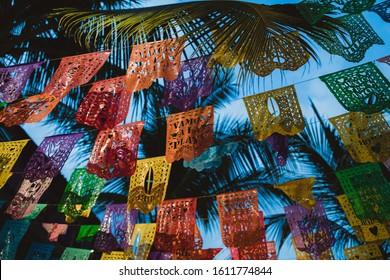 Sayulita, Nayarat, Mexico - January 2019: Festive flags fly in the streets in Sayulita