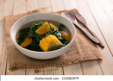 sayur bening bayam. indonesian food of spinach with soup and corn