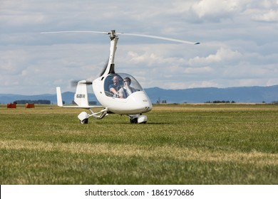 SAZENA, CZECH REP -July, 11, 2020. The two-seater gyroplane Calidus on the grass in S?zena Airport in the Czech Republic.