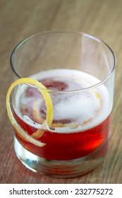 A Sazerac cocktail isolated on a wooden table