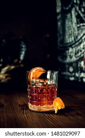 sazerac cocktail on dark wooden background with copy space, cocktail with whiskey toned