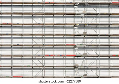 Scaffold against white wall. Can be used as background.
