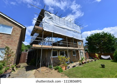 A Scaffold tower attached to a detached house in the UK