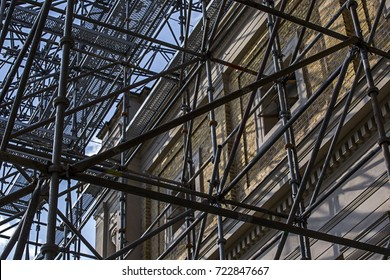 scaffolding against the backdrop of historical buildings