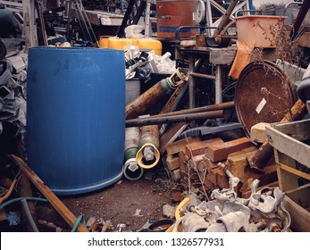 Scaffolding, bricks and various metal objects at a salvage yard in the UK.