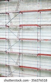 Scaffolding, construction site in progress. Building renovation