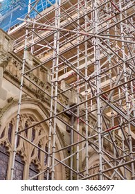 Scaffolding erected against a church tower for the purpose of refurbishment
