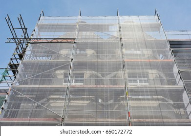 Scaffolding with Fall-Protection/Safety-Net for the Renovation of the Front of an old Business Building
