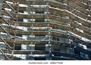 Scaffolding on the building under construction.