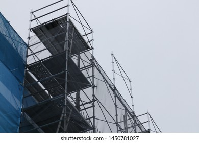 Scaffolding on the construction site and cloudy sky