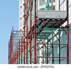 Scaffolding and scaffolding on a construction site with protection.