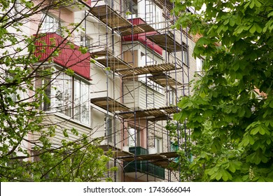 Scaffolding on the facade of an apartment building, multi-storey residential building, which is undergoing major repairs