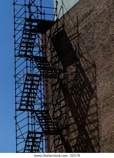 Scaffolding on the side of a building under construction.