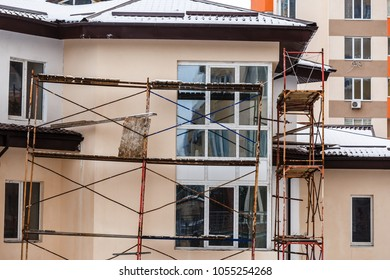 Scaffolding on the wall of a building repair of the facade of the house