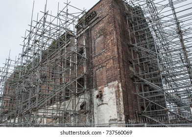 Scaffolding used to support old unstable industrial building, UK