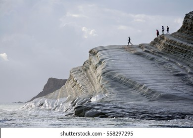 SCALA DEI TURCHI, PORTO EMPEDOCLE, SICILY/ITALY - SEPTEMBER 24th 2009 - Tourists walk along the famous white rock of the Scala dei Turchi, near Porto Empedocle in Southern Sicily, Italy.