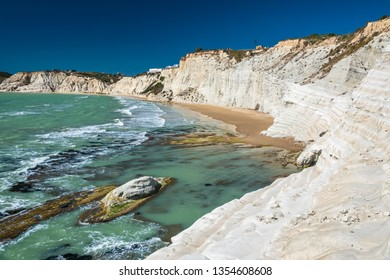 The Scala dei Turchi (Stair of the Turks), a spectacular white rocky cliff on the coast of Sicily, Italy. The rock formation in the shape of a staircase lies between two sandy beaches.