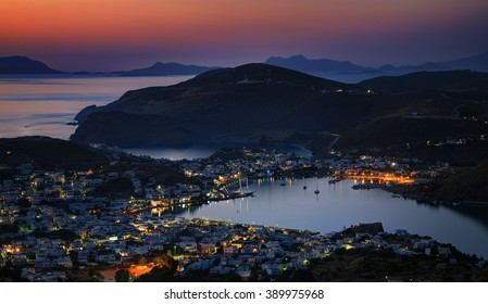 Scala town and harbour after sunset, of Patmos island, Greece