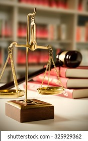Scale of Justice. Law composition with gavel on books in background