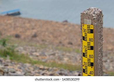 Scale to measure the water level or Staff gauge in Khun Dan Prakarnchon Dam, Thailand.