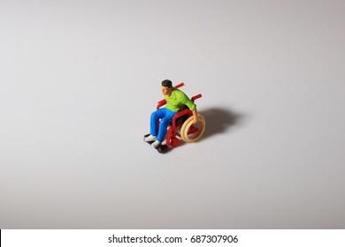 the Scale model man in a wheel chair on board