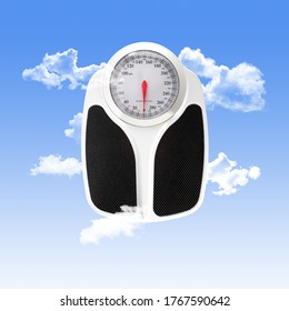 Scale Used for Personal Weighing with Clouds and a Blue Sky Background