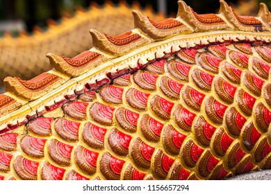 Scales of the dragon or serpent statue. Red and gold Dragon scales for background and texture.