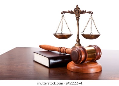 Scales, gavel and book on a table
