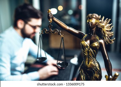 scales of justice against the background of a lawyer, a judge of the prosecutor. concept of jurisprudence