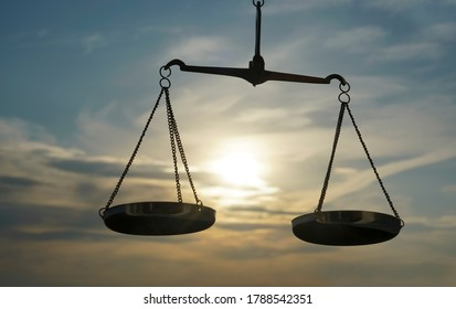 Scales of Justice background - legal law concept. a balance is hand-held, sky is the background.zodiac sign - libra