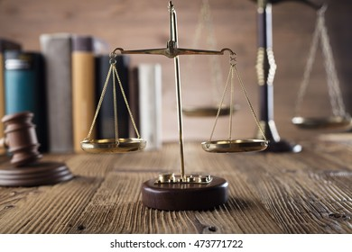Scales of justice, brown background, wooden table