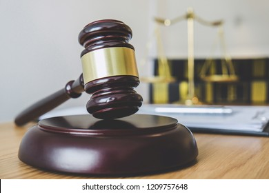 Scales of justice and Gavel on sounding block, object and law book to working with judge agreement in Courtroom, Justice and Law concept.
