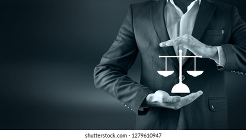 Scales of justice in the hands of a lawyer