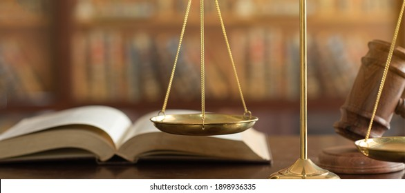 Scales of justice and law books with judge gavel. concept of justice, legal, jurisprudence. wide view.