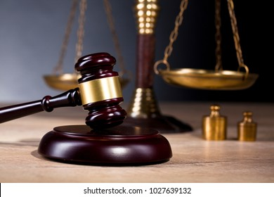 The scales of justice and legal hammer are the most popular law symbols on dark background