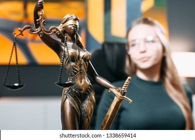 scales of justice in the office. The concept of jurisprudence, a young woman judge, lawyer, prosecutor.