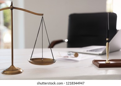 Scales of justice on desk in notary's office with space for text