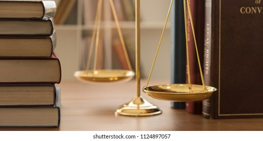 scales of justice on law books in library of law firm. concept of justice, legal, jurisprudence. legislation study.