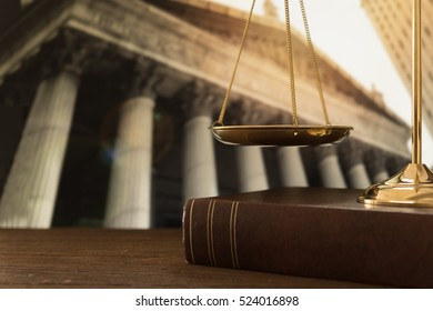 scales of justice on law books with court government background. concept of justice, legal, jurisprudence.
